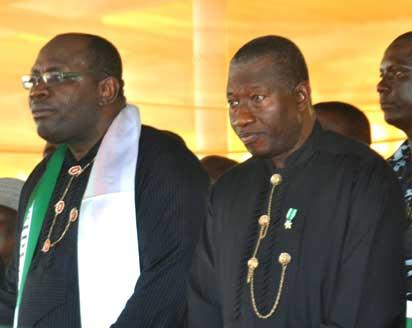 (Photo left)-Bayelsa State Governor Henry Seriake Dickson (left) receives former President Goodluck Jonathan (right) in the latter's hometown of Otuoke as he returned home on Democracy Day. Picture by Lindsay Barrett.