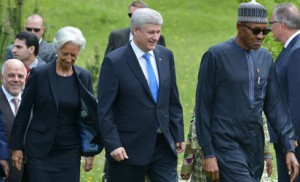 (LtoR) Iraq's Prime Minister  Haider al-Abadi, IMF Managing Director  Christine Lagarde, Canadian Prime Minister Stephen Harper, and Nigeria's President Muhammadu Buhari, arrive for the family photo of G7 leaders and outreach talks participants during the G7 Summit at the Schloss Elmau castle resort near Garmisch-Partenkirchen, in southern Germany on June 8, 2015. AFP PHOTO