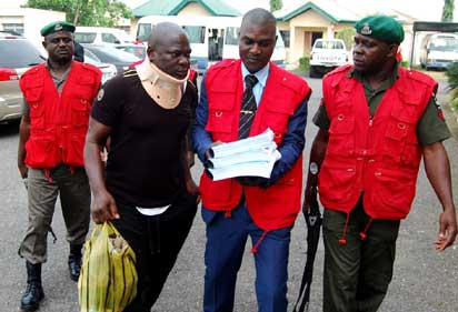 EFCC operatives leading fresh suspects in the N8 billion CBN staff fraud to the court premises in Ibadan, Oyo State, yesterday