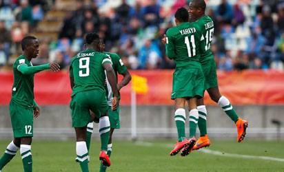 NEW PLYMOUTH, NEW ZEALAND - JUNE 01: Musa Yahaya #11 of Nigeria celebrates with team mates after he scores his teams second goal during the FIFA U-20 World Cup New Zealand 2015 Group E match between Nigeria and Brazil held at Stadium Taranaki on June 1, 2015 in New Plymouth, New Zealand.  FIFA