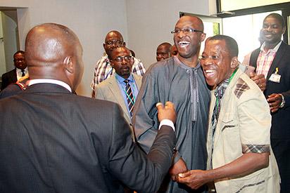 Vice Presidential Spokesman, Mr. Laolu Akande in a warm embrace with Mr. Bayo Obisesan (r) at a parley with State House Correspondents at the Presidential Villa, Abuja. Photo by Abayomi Adeshida