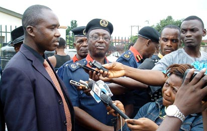 NAFDAC/NSCDC: Mr. Francis Ononiwu, Assistant Director, Investigation and Enforcement Directorate, National Agency for Food and Drug Administartion and Control, Nafdac, (left) and Mr. Gabriel Abafi, Commandant, Nigeria Security and Civil Defense Corps, Nscdc, Lagos, speaking to newsmen during the parade of suspected dealers in fake bottled wine and juices in Lagos.