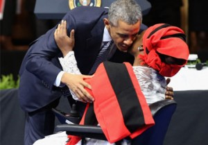 WASHINGTON, DC - AUGUST 03: U.S. President Barack Obama embraces Nigerian disability-rights activist and musician Grace Alache Jerry during the Young African Leaders Initiative (YALI) Mandela Washington Fellowship Presidential Summit at the Omni Shoreham Hotel August 3, 2015 in Washington, DC. Identified as Sub-Saharan Africa's 'most promising young leaders,' 500 people were invited by the U.S. State Department for the three-day summit where they interact with representatives from the public, private, and non-profit sectors. AFP