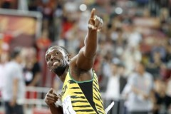 "Jamaica's Usain Bolt makes his trademark celebration pose after winning the final of the men's 200 metres athletics event at the 2015 IAAF World Championships at the ""Bird's Nest"" National Stadium in Beijing on August 27, 2015.  AFP PHOTO / ADRIAN DENNIS"
