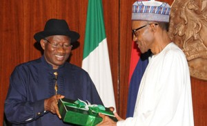 Former President, Dr Goodluck Jonathan handing over reports of the 2014 National Conference to President Muhammadu Buhari