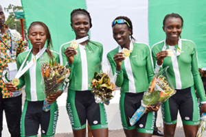 GOLDEN QUARTET: Happiness Okafor, Rosemary Marcus, Gripa Tombrapa and Glory Odiase display their medals after winning the women's time trial cycling event in Congo yesterday.