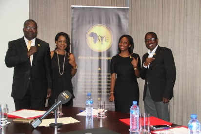 Members of the Africa's Young Entrepreneurs Economic Development Team pose with their lapels.