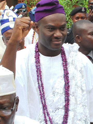 Ooni designate, Prince Adeyeye Enitan Ogunwusi acknowledging cheers from the crowd on his arrival in Ile-Ife yesterday. Pix By Gbenga Olarinoye