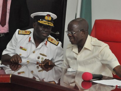 Rear Admiral Samuel Alade, Commandant, Natiional Defence College (left) and Governor Adams Oshiomhole during a visit of participants of the National Defence College, Course 24 to the Governor in his office, Friday.