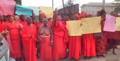 Women half nude protests against Oshiomhole's move to probe Chief Igbinedion