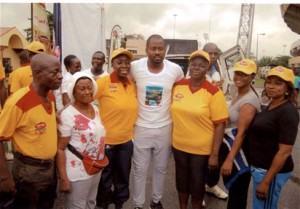 Hon. Desmond Elliot flanked by Mrs. Elizabeth Ariyo,  the Perm. Sec. Lagos state Ministry of Education, Mrs.  Lola Areadegbite, Tutor-General, Perm Sec District for Lagos and others at the Surulere Women Walk exercise.