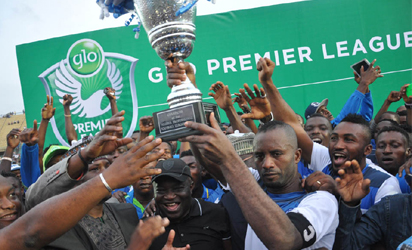 Glo Premier League Trophy Presentation... From left, Chairman of the League Management Company, Mallam Shehu Dikko, Governor of Abia State, Dr. Okezie Ikpeazu, NFF 1st Vice President, Barrister Seyi Akinwumi and Enyimba captain, Chinedu Udoji at the Teslim Balogun Stadium in Lagod.