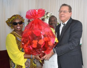 Consulate General of United State of America,Mr F.John Bray right with Bouquet flower for Mama Awolowo presenting to Mama grand daughter,Mrs Yemisi Subair left; .DURING THE LAYING-IN STATE OF MAMA HID AWOLOWO AT PARK LANE,APAPA,LAGOS.PHOTO BY AKEEM SALAU