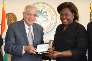 "L-r: Hon. Mayor Tomas Regalado of City of Miami, Florida, USA presenting the ""Key to the City"" of Miami, Florida to Justice Chioma Nwosu-Iheme at the historic City Hall in the Coconut Grove area of Miami, Florida"