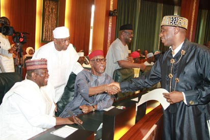 National Chairman All Progressives Congress, Chief Odigie Oyegun congratulating the Minister for Transportation, Hon. Chibuike Amaechi while Chairman Nigeria Governors' Forum, Governor Abdulaziz Yari of Zamfara State (l) and Patron, Newspapers Proprietors Association of Nigeria, Malam Ismaila Isa watched during the swear-in ceremony of the newly composed Federal Executive Council at the Aso Chambers, Presidential Villa, Abuja. Photo by Abayomi Adeshida 11/11/2015