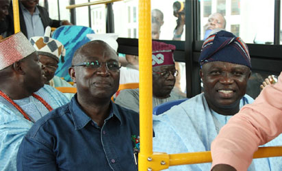 Lagos State Governor, Mr. Akinwunmi Ambode (right); Commissioner for Transportation, Dr. Dayo Mobereola (left); APC National Leader, Asiwaju Bola Tinubu (right, behind) and some traditional rulers, during the commissioning of Mile 12-Ikorodu BRT Extension and launching of new BRT, on Thursday, November 12, 2015.