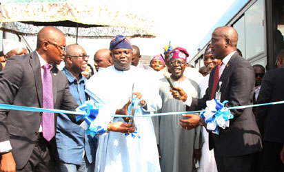 Lagos State Governor, Mr. Akinwunmi Ambode (2nd left), cutting the tape to commission the Mile 12-Ikorodu BRT Extension and launching of new Bus Rapid Transit, on Thursday, November 12, 2015. With him are Osun State Governor, Ogbeni Rauf Aregbesola (right); APC National Leader, Asiwaju Bola Tinubu (2nd right) and Commissioner for Transportation, Dr. Dayo Mobereola (left).