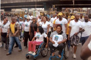 "Hon. Desmond Elliot with some of the physically challenged in Surulere during the ""Surulere Women Walk."""