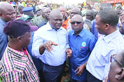 Lagos State Governor, Mr. Akinwunmi Ambode (middle) with the Secretary to the State Government, Mr Tunji Bello (middle) and member, Lagos State House of Assembly, Alimosho Constituency, Hon. Bisi Yusuf (2nd left) during the Governor's inspection of Ayetoro road, Ipaja-Ayobo, recently..