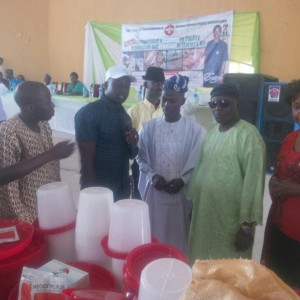 Hon. Obasa (in white) donating poultry kits