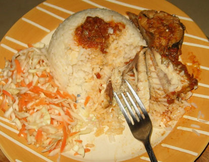 On a plate of rice, experts say you should eat the fish or meat first.