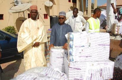 FRCN Director-General, Ladan Salihu (middle) and his entourage with the gift items at Dalori Camp, Maiduguri, Borno State