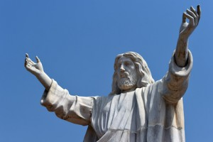 "A picture taken on January 1, 2016 shows the nine-metre tall statue of Jesus Christ carved from white marble, thought to be the biggest of its kind in Africa, unveiled in Abajah, southeastern Nigeria. Standing barefoot with arms outstretched, the ""Jesus de Greatest"" statue weighs in at 40 tonnes. More than 100 priests and hundreds of Catholic worshippers attended the nine-metre (30-foot) statue's official unveiling in the village of Abajah in southeastern Nigeria. It was commissioned by Obinna Onuoha, a local businessman who hired a Chinese company to carve it and placed it in the grounds of a 2000-capacity church that he built in 2012. / AFP"