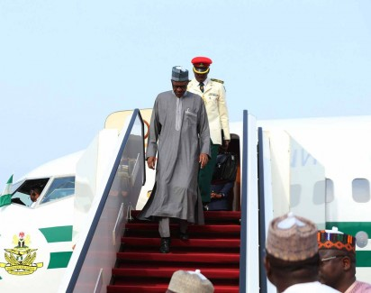 PRESIDENT BUHARI ARRIVED FROM QATAR 0A President Muhammadu Buhari  on his Arrival from Qatar and Saudi Arabi with Parade of gaurds at the Nnnamdi Azikwe International after his official visit to Qatar and Saudi Arabi in Abuja.