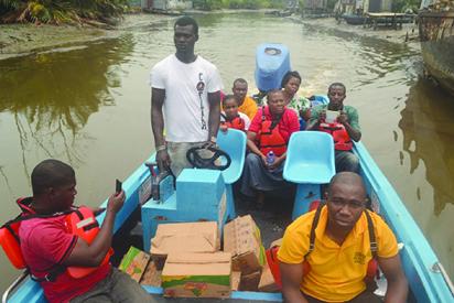 •The CROWE/EWEF health, food charity mission team sailing on the journey to Ugborodo.