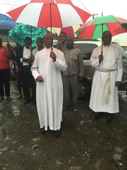 Ven. Levi Opara and other members of St. Paul's Anglican Church during their protest to call government's attention on the state of Dillion Street, in Kirikiri area of Lagos State.