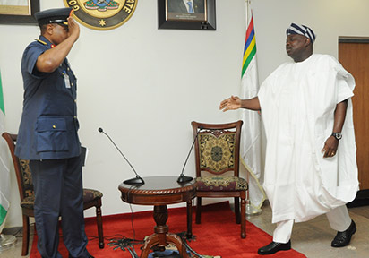 Lagos State Governor, Mr. Akinwunmi Ambode (right), being saluted by the Chief of Air Staff, Air Marshal Saddiq Baba Abubakar (left) during a courtesy visit to the Governor, at the Lagos House, Ikeja on Tuesday, April 19, 2016.