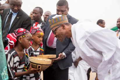 File: PRESIDENT MUHAMMADU BUHARI WITH SOME CHILDREN WHO PRESENTED HIM WITH A CALABASH CONTAINING KOLANUT DURING HIS ARRIVAL AT THE NIAMEY INTERNATIONAL AIRPORT NIGER REPUBLIC ON WEDNESDAY (2/6/15).