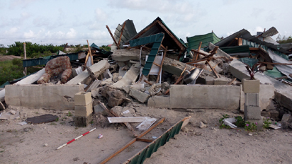 *Demolished structures at Okun Mopo community
