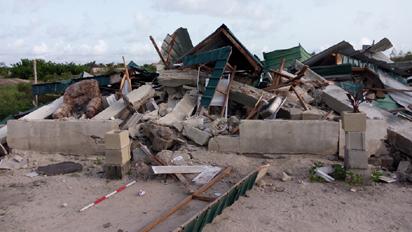 *Demolished structures at Okun Mopo community