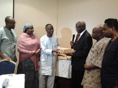 •Prof Izevbaye (third left) receiving the entries from Prof Banjo (third right), with them are the members of panel of judges and advisory board at the handover ceremony in Lagos