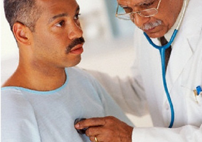 A doctor checking the heart beat of a patient