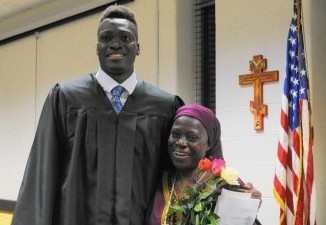 Mike Tertsea, a John Carroll senior from Nigeria, was surprised to learn his class pitched in to help bring his mother, Felicia Ikpum, in for his graduation after being apart for four years. (Baltimore Sun)