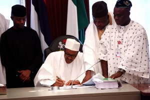 Budget 2016:  President Buhari , Vice President Yemi Osinbajo,  with others during the  signing of the 2016 budget into Law on 6th May ,2016.