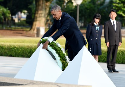 "US President Barack Obama places a wreath at the cenotaph in the Peace Momorial park in Hiroshima on May 27, 2016 with Japanese Prime Minister Shinzo Abe. Obama on May 27 paid a moving tribute to victims of the world's first nuclear attack. / AFP PHOTO / TOSHIFUMI KITAMURA / ""The erroneous mention[s] appearing in the metadata of this photo by TOSHIFUMI KITAMURA has been modified in AFP systems in the following manner: [removing reference to POOL] instead of [POOL]. Please immediately remove the erroneous mention[s] from all your online services and delete it (them) from your servers. If you have been authorized by AFP to distribute it (them) to third parties, please ensure that the same actions are carried out by them. Failure to promptly comply with these instructions will entail liability on your part for any continued or post notification usage. Therefore we thank you very much for all your attention and prompt action. We are sorry for the inconvenience this notification may cause and remain at your disposal for any further information you may require."""