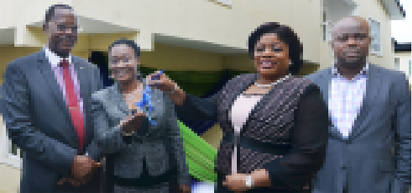 Mrs. Clara Ego Ibedu(2nd left) receiving the keys of the brand new 4-bedroom duplex she won under the auspices of the Fidelity Bank Save 4 Shelter promo