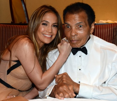 """(FILES) This file photo taken on March 22, 2013 shows Singer Jennifer Lopez and boxer Muhammad Ali attending Muhammad Ali's Celebrity Fight Night XIX at JW Marriott Desert Ridge Resort & Spa in Phoenix, Arizona.    Boxing icon Muhammad Ali died on Friday, June 3, a family spokesman said in a statement. """"After a 32-year battle with Parkinson's disease, Muhammad Ali has passed away at the age of 74,"""" spokesman Bob Gunnell said.  / AFP PHOTO"""