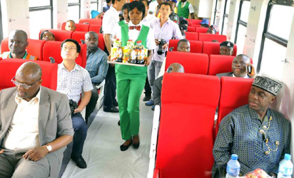 Minister Of Transportation, Mr Chibuike Amaechi (r); Director of Rail Transportation, Mr Mohammed Babakobi (l), and other passengers test-riding in the first Class Coach of the Abuja-Kaduna Train Service from Idu Main Station to Kuchbun at Kubwa In Abuja On Wednesday (1/6/16).