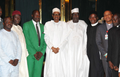President Muhammadu Buhari flanked by the SGF, David Babachir Lawal and the leader, Northern Christian Leaders Eagle Eyes Forum, Pastor Aminchi Habu in a group photograph when the Forum paid a visit to the President at the State House, Abuja. Photo by Abayomi Adeshida