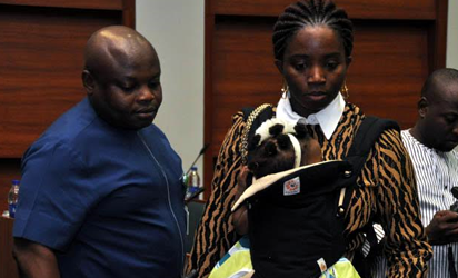 Alleged sexual misconduct Member of House of Representatives, Hon. Mike Gbella and his wife with their baby during an investigative hearing of an alleged sexual misconduct Members of House of Representatives by the United of America Ambassador to Nigeria at the National Assembly in Abuja, Yesterday. Photo by Gbemiga Olamikan.