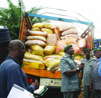 File: Rice-Smugglers intercepted by Customs