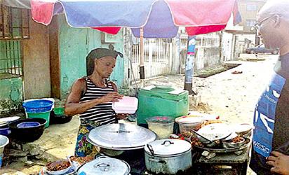 Roadside food joint:  Vendor selling food to buyer