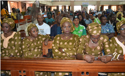 A cross section of family relations during the church service in Benin.