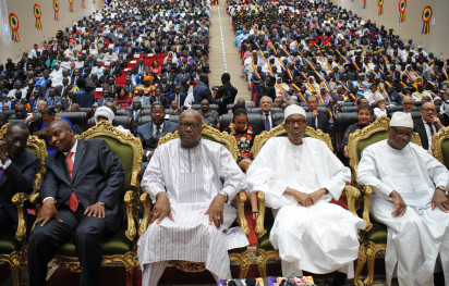 "(L-R) Benin's president Patrice Talon, Central African Republic's president Faustin-Archange Touadera, Burkina Faso's president Roch Marc Christian Kabore, Nigeria's president Muhammadu Buhari, Mali's president Ibrahim Boubacar look on during the inauguration of Chad's president Idriss Deby (not pictured) for his fifth term as president on August 8, 2016 in N'Djamena.  Chad's President Idriss Deby took the oath of office August 8 for a fifth term in power, facing dogged resistance from an opposition that alleges his re-election was a ""political hold-up"". With tensions high a day after the death of a protester during an opposition march, around 14 African heads of state attended the swearing-in ceremony, including the presidents of Nigeria and Niger, both, like Chad, battling the Boko Haram jihadist group.  / AFP PHOTO / BRAHIM ADJI"