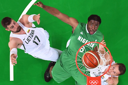 An overview shows (From L) Lithuania's centre Jonas Valanciunas, Nigeria's power forward Ike Diogu and Lithuania's power forward Paulius Jankunas eye a rebound during a Men's round Group B basketball match between Lithuania and Nigeria at the Carioca Arena 1 in Rio de Janeiro on August 9, 2016 during the Rio 2016 Olympic Games. / AFP PHOTO