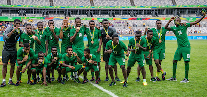 Nigeria's players celebrate after receiving their bronze medals after defeating Honduras in the Rio 2016 Olympic Games men's bronze medal football match at the Mineirao stadium in Belo Horizonte, Brazil, on August 20, 2016.  / AFP PHOTO /